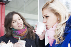 Conflict among friends. Girlfriends have a conflict on outdoors with coffee Royalty Free Stock Photo