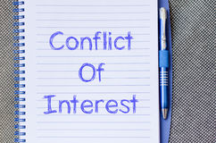 Conflict of interest write on notebook Royalty Free Stock Photos