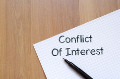 Conflict of interest write on notebook. Conflict of interest text concept write on notebook with pen royalty free stock photography