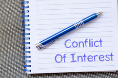 Conflict of interest write on notebook Royalty Free Stock Photo