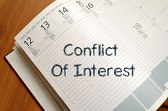 Conflict of interest write on notebook. Conflict of interest text concept write on notebook with pen Stock Images