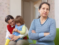 Conflict of intergenerational. Sad mature grandmother Stock Photography