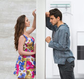 Conflict between man and woman. Conflict between men and women standing on either side of a wall Royalty Free Stock Photography