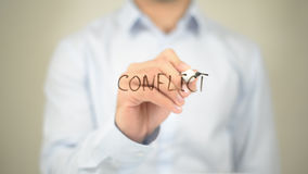 Conflict, Man writing on transparent screen Stock Photo