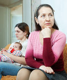 Conflict between the mature mother and daughter Royalty Free Stock Image