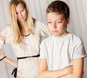 Conflict. Mom swears by son. Conflict, problems in family. Sad mother and child royalty free stock photography
