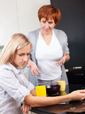 Conflict between mother and daughter Stock Photos