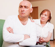 The conflict between mother and son. Domestic quarrel between adult son and senior mother Royalty Free Stock Image