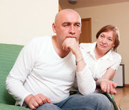 The conflict between mother and son. Domestic quarrel between adult son and senior mother Stock Images
