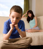 Conflict between mum and the son Stock Photography