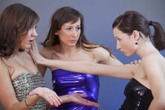 Conflict on the party. Conflict between female friends on the party - shot in studio Royalty Free Stock Photos