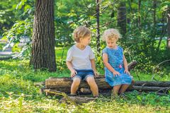 Conflict on the playground, resentment, Boy and girl quarrel Stock Images
