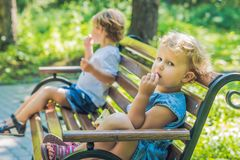Conflict on the playground, resentment, Boy and girl quarrel Stock Photo