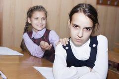 Conflict and schoolgirl Stock Photos