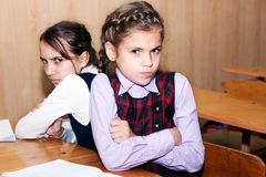 Conflict and schoolgirl. The conflict between the little schoolgirl in the classroom Stock Photography