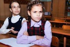Conflict and schoolgirl Stock Image