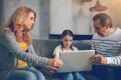 Mindful parents trying to talk to depressed daughter Stock Photo