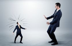 Conflict between small and big businessman. Conflict between small masked businessman and big elegant businessman royalty free stock image