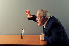 Conflict between small woman and senior man Stock Photo