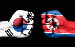Conflict between South Korea and North Korea - male fists stock image