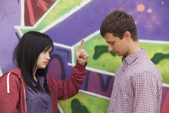 Conflict teens near graffiti wall. Royalty Free Stock Photography