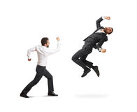 Conflict between two businessmen Royalty Free Stock Image