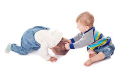 Conflict of two children. Studio shooting Royalty Free Stock Photography