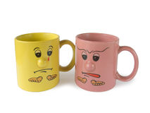 Conflict (two cups with faces). Isolated on white Royalty Free Stock Photography