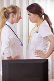 Conflict between two women doctors Royalty Free Stock Photography