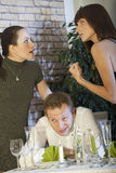 Conflict between two women because of man Stock Images