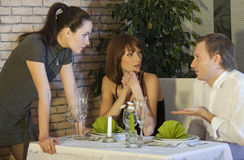 Conflict between two women and man Royalty Free Stock Photo