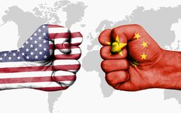 Conflict between USA and China - male fists. Conflict between USA and China, male fists - governments conflict concept Royalty Free Stock Photography