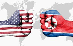Conflict between USA and North Korea - male fists. Conflict between USA and North Korea, male fists - governments conflict concept royalty free stock images