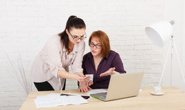 Conflict. Women discuss project in office Stock Image
