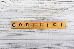CONFLICT word made with wooden blocks concept Stock Images