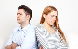 Conflict between a young couple. Young couple with a conflict sitting speechless in the living room Stock Images