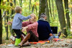Conflicts of being dad. Family and career goals. Dad is always busy. Family day concept. Family with kid boy relaxing in royalty free stock photography