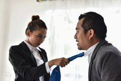 Conflicts in the workplace of women and men. Encourage violence and abuse.Business Communication Connection Working Concept stock photos