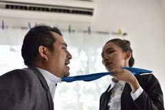 Conflicts in the workplace of women and men. Encourage violence and abuse.Business Communication Connection Working Concept royalty free stock photo