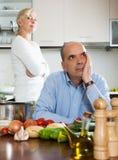 Conflit de famille dans la cuisine Photo stock