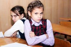Conflit et écolière Photographie stock