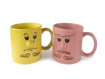 Conflito (dois copos com faces) Fotografia de Stock Royalty Free
