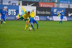Conflito dos jogadores no jogo de futebol Foto de Stock Royalty Free