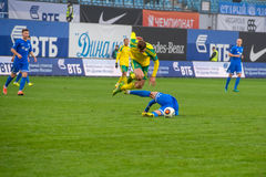 Conflito dos jogadores no jogo de futebol Imagem de Stock Royalty Free