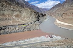 Confluence of the Indus and Zanskarar rivers, Ladakh, India. Confluence of the Indus River and the Zanskar river in a valley near NImmu village in Ladakh, india Royalty Free Stock Images