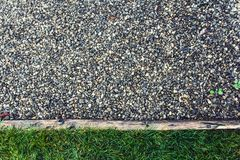 Confluence of life and still life. Grass, wood and gravel paving stock photos
