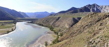 Confluence of mountain rivers Chuya and Katun Stock Photos