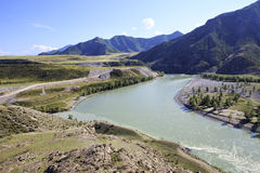 Confluence of mountain rivers Chuya and Katun Stock Images