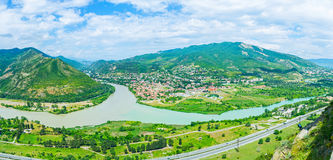 The confluence of Mtkvari and Aragvi rivers. The mountain landscape of Mtskheta-Mtianeti region in place of confluence of Mtkvari (Kura) and Aragvi rivers with Royalty Free Stock Image