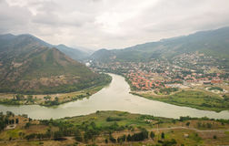 Confluence of Mtkvari Kura and Aragvi rivers, Georgia. Panoramic View Of place of confluence of Mtkvari Kura and Aragvi rivers with the Mtskheta city on the bank Stock Photos